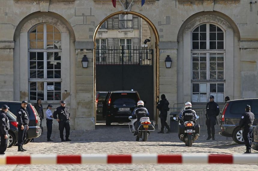 Police officers escort vehicles thought to be transporting Mehdi Nemmouche - the French national suspected of a shooting attack at the Brussels Jewish Museum last month that left four people dead - as he arrives for an extradition hearing at the Appe