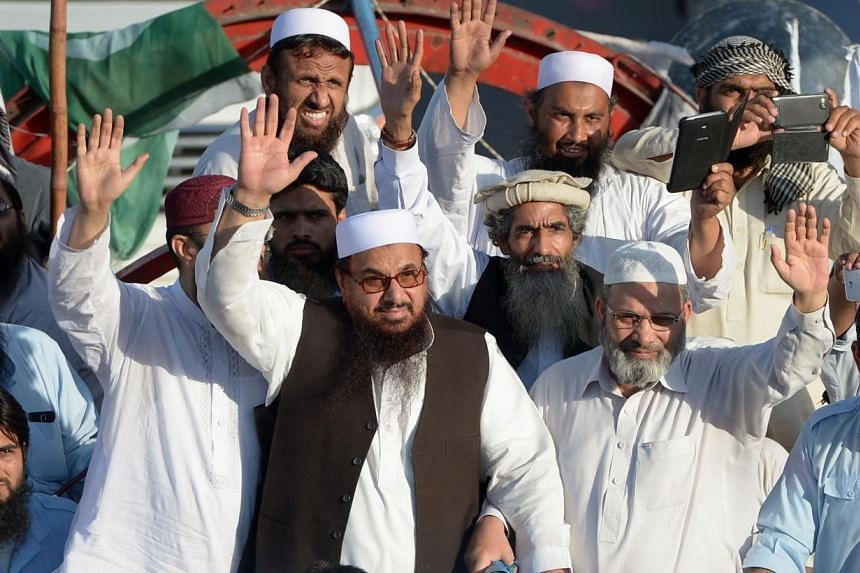 Jamat-ud-Dawa leaderHafiz Saeed (centre) waving alongside others at a rally in Islamabad last month. In 2012, the United States offered a US$10 million reward for information leading to the arrest of Saeed, the founder of Lashkar-e-Taiba, a Pak