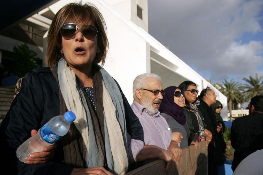 A picture taken in May shows Libyan human rights activist Salwa Bugaighis (left), who was shot dead by unknown assailants at her home in the restive east Libyan city of Benghazi late on Wednesday. She was shot several times and was taken to hospital