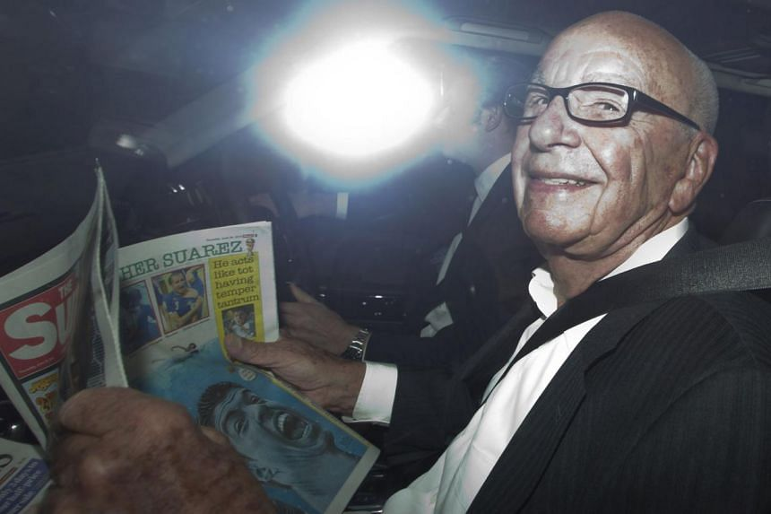 Media mogul Rupert Murdoch being driven away from his home in central London on June 26, 2014. A spokesman for Mr Murdoch declined to comment on his plans while in London, but the Guardian newspaper reported this week that British police want to ques