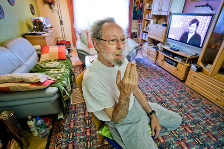 A photo from last year shows German Friedhelm Adolfs, 75, smoking in the living room of his flat in Duesseldorf, northwestern Germany. A German court ruled on June 26, 2014 that Adolfs must vacate his home of around 40 years after neighbours complain