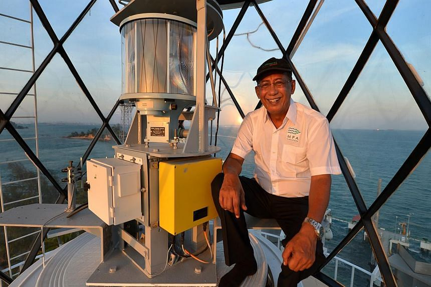 Mr Syed Hassan Syed Agil Al-Yahya at the top of the Raffles Lighthouse, situated on Pulau Satumu, Singapore's southernmost island. He is a lighthouse keeper and the oldest in Singapore. For days at a time, he resides in Raffles Lighthouse, which is a