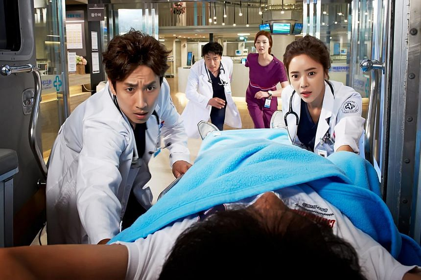 In medical dramedy Golden Time, Lee Seon Gyun (far left) plays an inept doctor whose life changes after a patient's death.