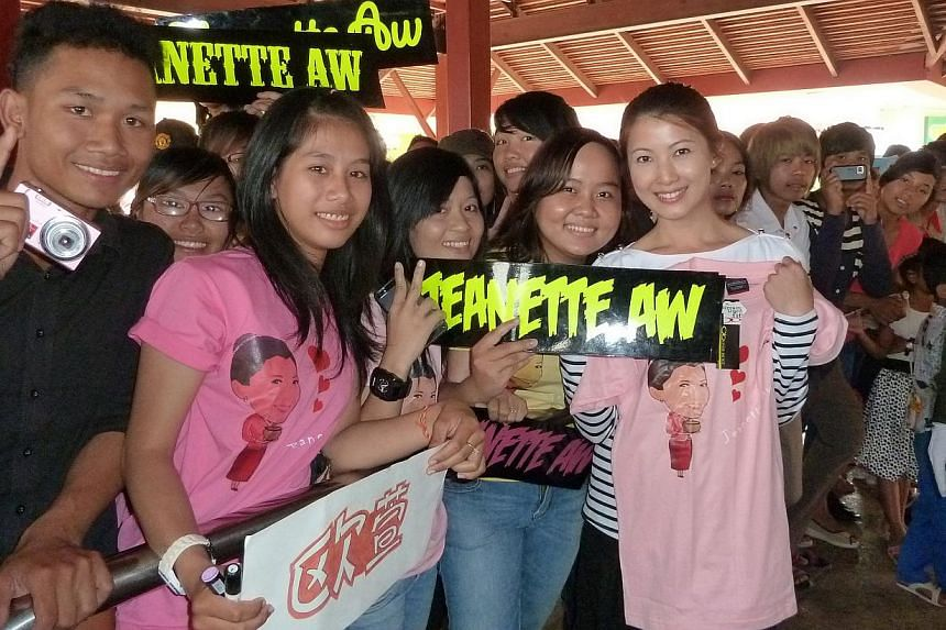 Actress Jeanette Aw (far right), who was named Most Popular Regional Artiste in Cambodia at this year's Star Awards, with her fans in the country.