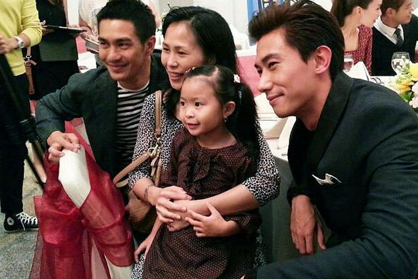 Actor Elvin Ng (in grey) at a fan meet in Cambodia, where members of his local fan club turned up. This year's Star Awards saw actresses Yvonne Lim (above left) being named Most Popular Regional Artiste in China and Rui En (above right) in Indonesia