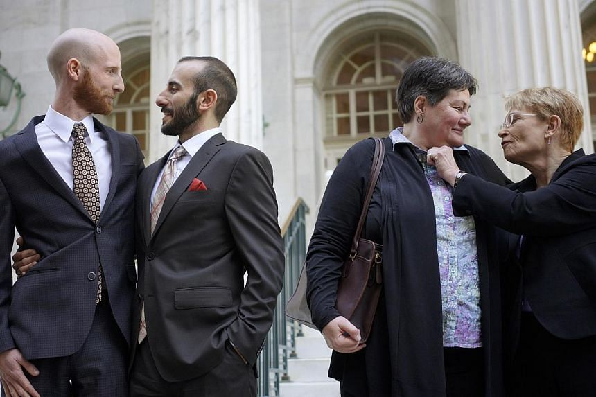 (Left to right) Plaintiffs Derek Kitchen, Moudi Sbeity, Kate Call and Karen Archer talk outside the courthouse after a federal appeals court heard oral arguments on a Utah state law forbidding same sex marriage in Denver in an April 10, 2014 file pho