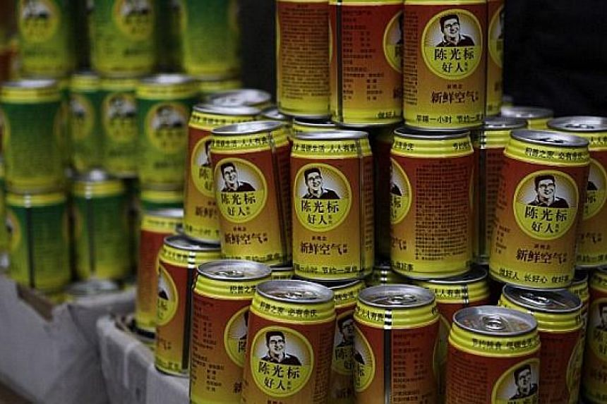 Canned air produced by Chen Guangbiao's company. -- PHOTO: REUTERS