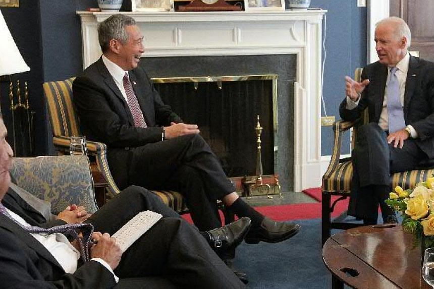 Singapore Prime Minister Lee Hsien Loong meets with United States Vice-President Joe Biden at his office in the White House, Washington DC, USA, on June 25, 2014. -- ST PHOTO: NEO XIAOBIN