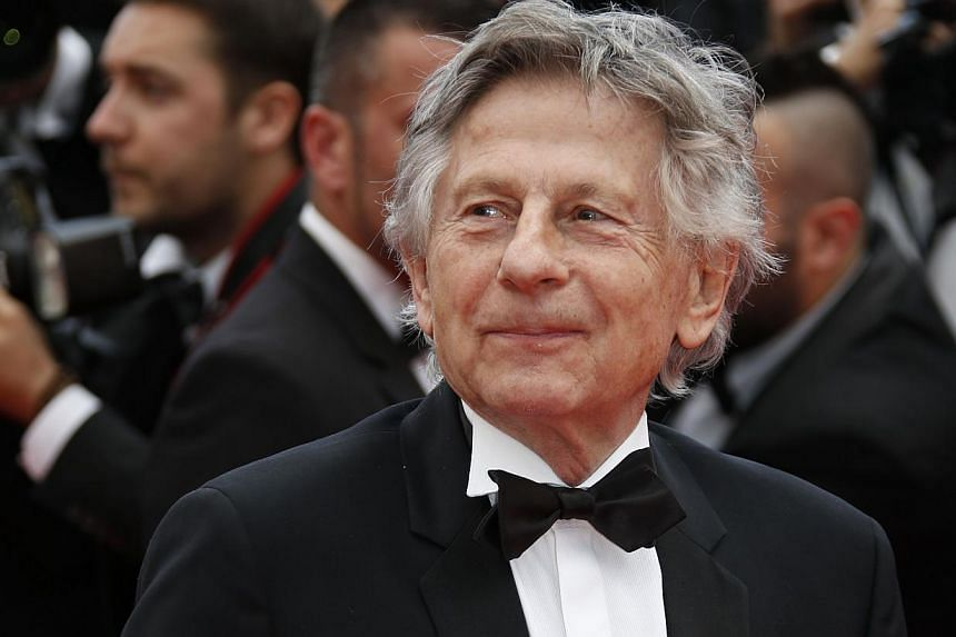 French director Roman Polanski poses as he arrives for the screening of the film Saint-Laurent at the 67th edition of the Cannes Film Festival in Cannes, southern France, on May 17, 2014. -- PHOTO: AFP