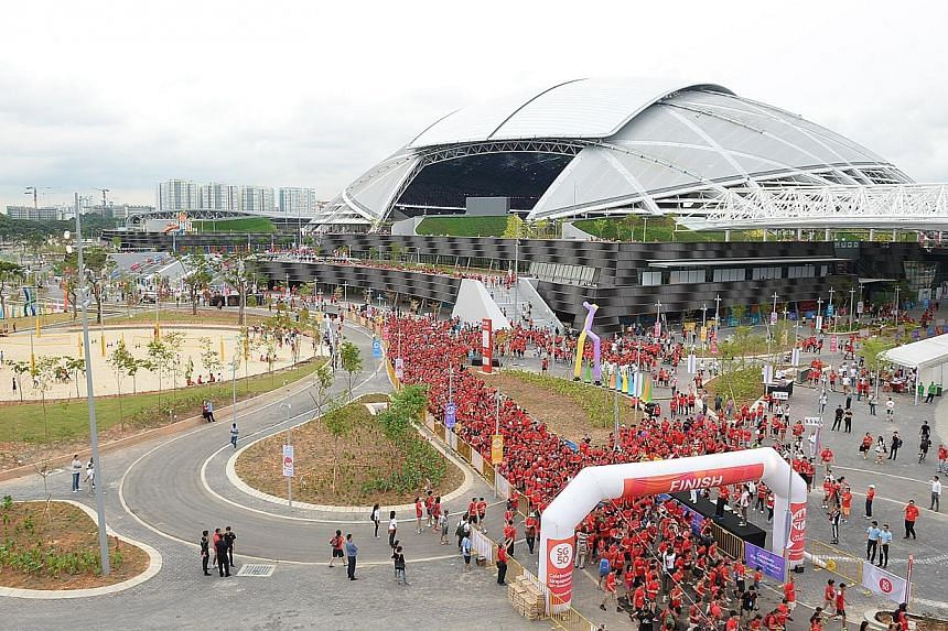 Visitors came to walk around the Sports Hub on Friday, June 27, 2014. -- ST PHOTO: DESMOND WEE