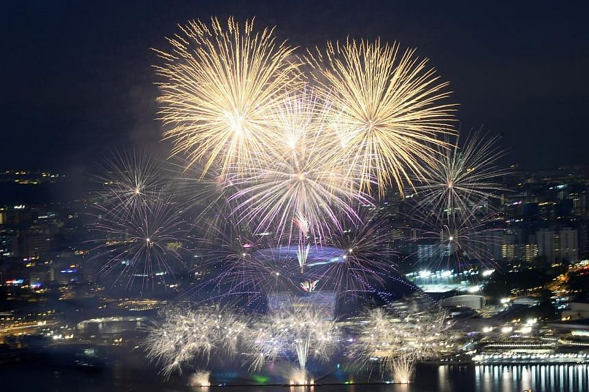 Fireworks lit up the skies above the Sports Hub on Friday, June 27, 2014, as thousands of Singaporeans explored for the first time the long-awaited venue. -- ST PHOTO:MARK CHEONG