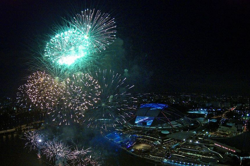 Fireworks lit up the skies above the Sports Hub on Friday, June 27, 2014, as thousands of Singaporeans explored for the first time the long-awaited venue.-- ST PHOTO:KEVIN LIM