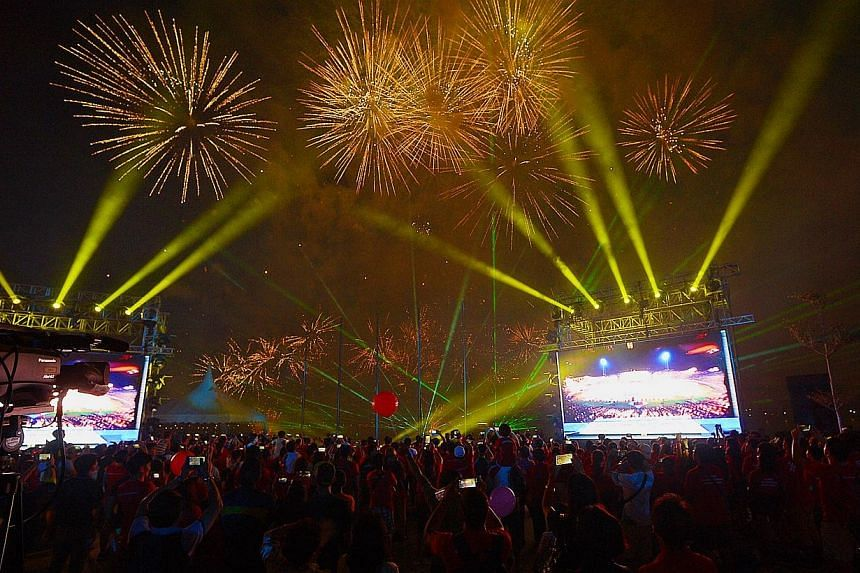 Fireworks lit up the skies above the Sports Hub on Friday, June 27, 2014, as thousands of Singaporeans explored for the first time the long-awaited venue.-- ST PHOTO:DESMOND WEE