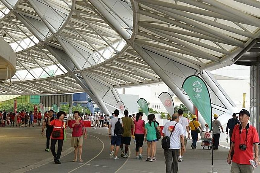 Visitors came to walk around the Sports Hub on Friday, June 27, 2014. -- ST PHOTO:DESMOND WEE