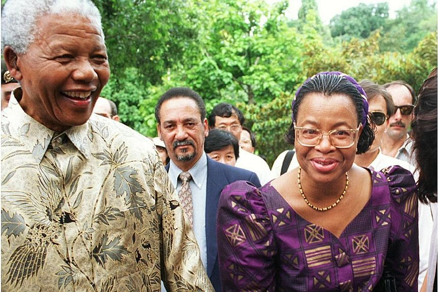 """Nelson Mandela's widow, Graca Machel, (right), announced she will resume her public life after completing a six-month mourning period for her """"best friend"""". -- PHOTO: ST FILE"""