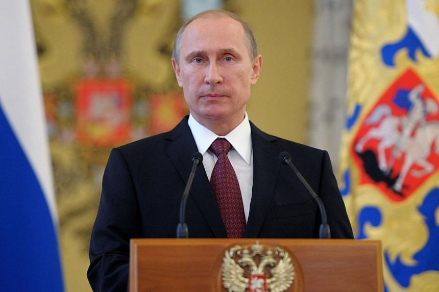 Russia's President Vladimir Putin attends a reception in honour of the military academies' graduates in the Kremlin in Moscow, on June 26, 2014. Mr Putin called on Friday, June 27, 2014, for a long-term ceasefire in Ukraine to allow for talks between