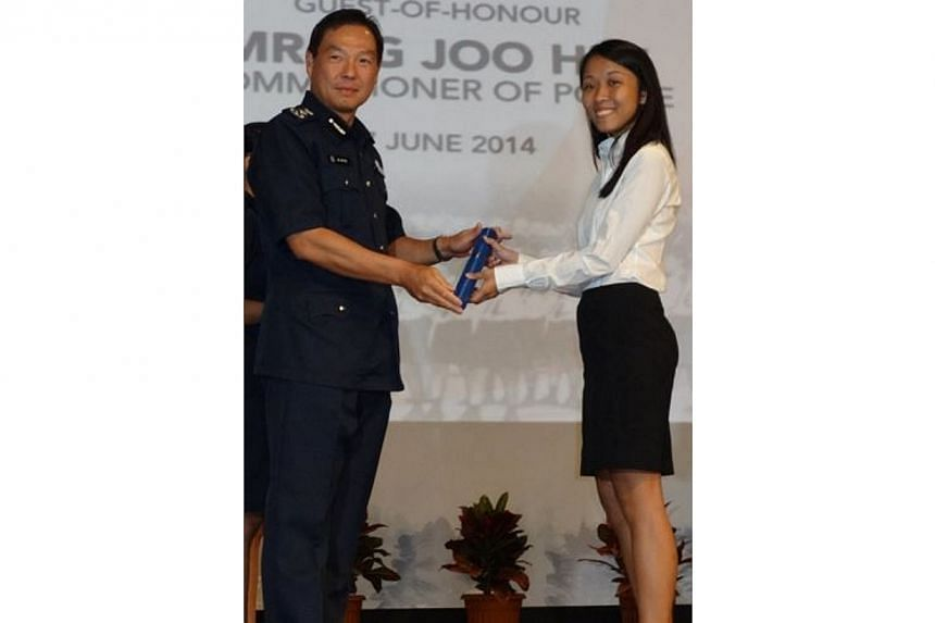 Commissioner of Police Mr Ng Joo Hee (left) presenting the Individual Commendation Certificate to Ms Sharon Xie of the Financial Investigation Division, Commercial Affairs Department. Ms Xie was involved in several notable commercial crime cases, inc