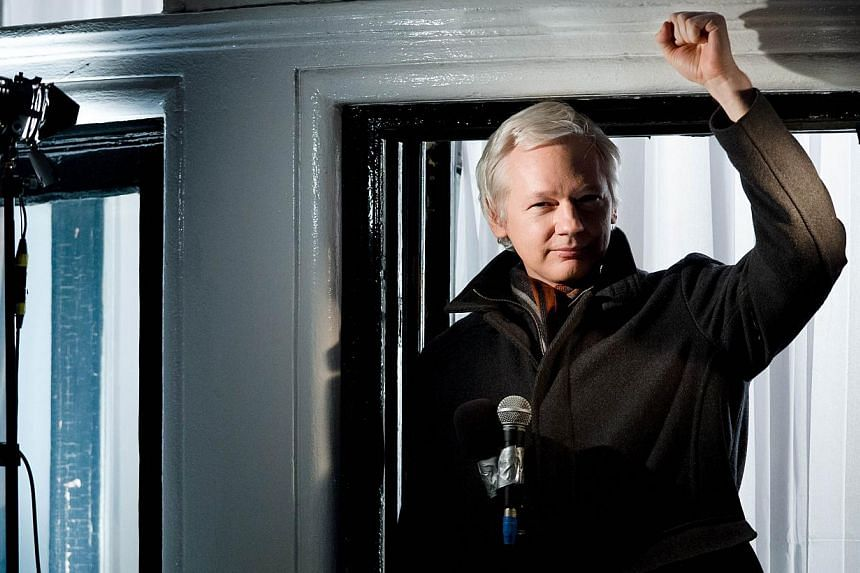 In this file picture taken on December 20, 2012 Wikileaks founder Julian Assange addresses members of the media and supporters from the window of the Ecuadorian embassy in Knightsbridge, west London. -- PHOTO: AFP