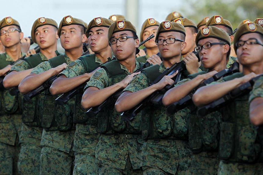 Soldiers from the Singapore Armed Forces (SAF) during the march pass at the SAF Day Parade held at Safti Military Institute on July 1, 2013. -- PHOTO: ST FILE