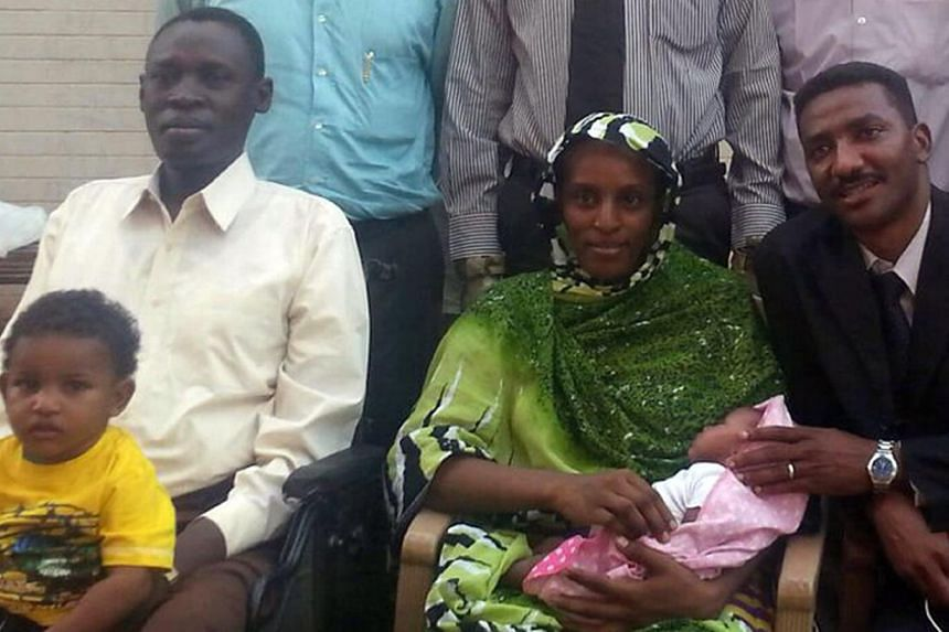 Ms Meriam Yahia Ibrahim Ishag posing for a smartphone photo at an undisclosed location with her husband Daniel Wani (left), her newborn baby, their 20-month-old son, lawyer Mohamad Mustafa (right) and other members of her legal team (cropped) on June