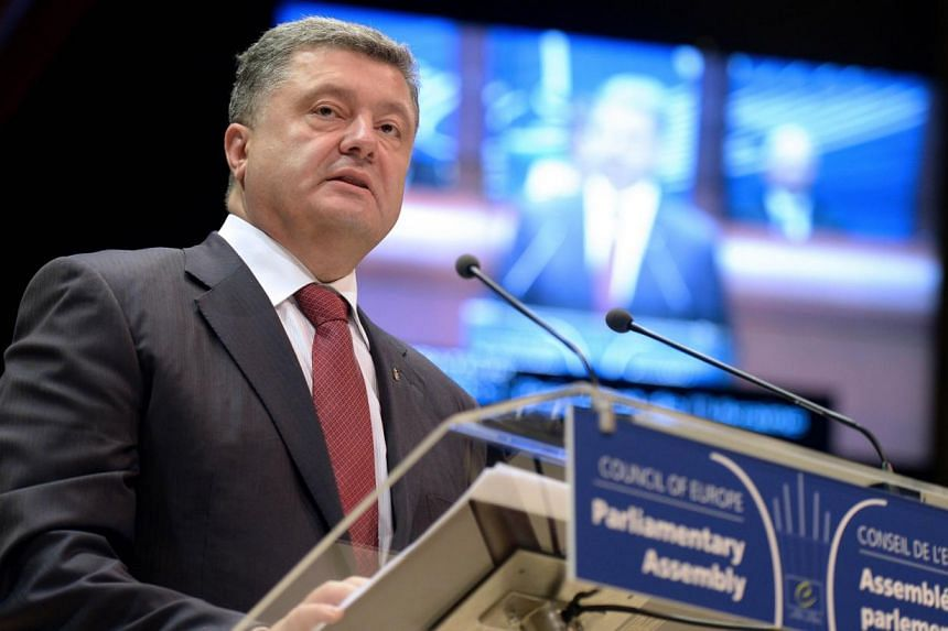Ukraine President Petro Poroshenko delivering a speech to the Council of Europe parliamentary assembly in Strasbourg, eastern France, on Thursday. As he arrived for Friday's signing ceremony for an accord between the EU and Ukraine, he said the deal
