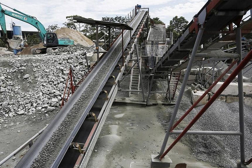 Rocks are crushed and loaded onto a truck at Samwoh's recycling plant.