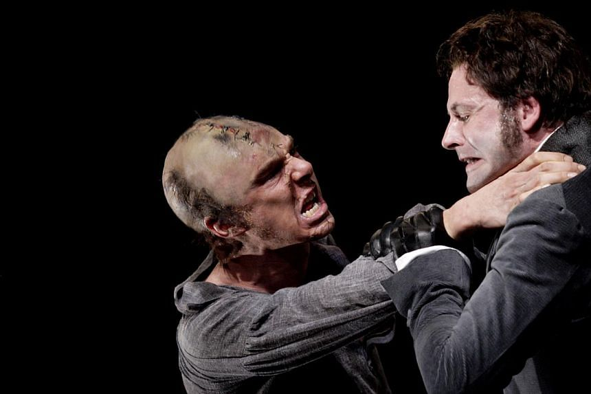 Benedict Cumberbatch (of TV series Sherlock fame) as the monstrous Creature and Jonny Lee Miller (who also plays the revered detective in the TV series Elementary) as the scientist Victor Frankenstein (both above). -- PHOTO: CATHERINE ASHMORE