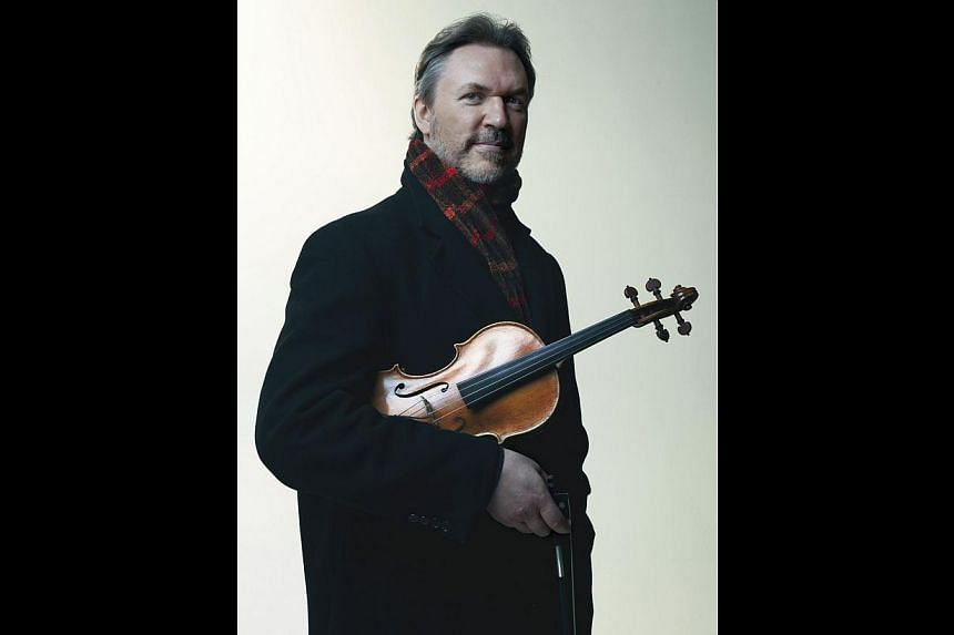 Violinist Mark O'Connor will play with the Singapore Chinese Orchestra three of his own compositions which will be adapted for Chinese instruments. -- PHOTO: SINGAPORE CHINESE ORCHESTRA