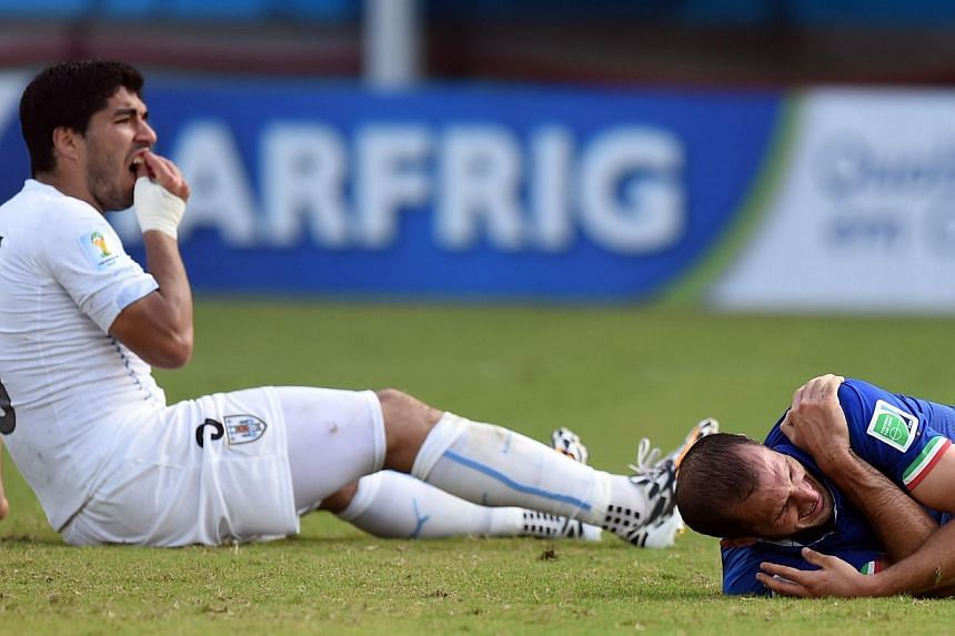 Italy's Giorgio Chiellini (right) holding on to his shoulder after being allegedly bitten by Uruguay's Luis Suarez during their World Cup game on Tuesday. Football has had a violent history that included kickabouts with the heads of defeated enemies,