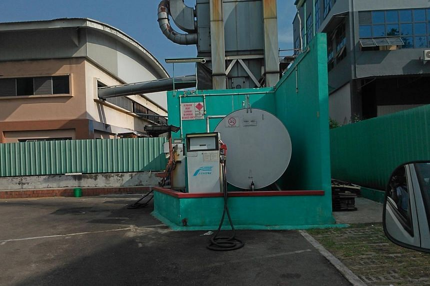 The Straits Times had no trouble filling up at this pump at a furniture factory in Sungei Kadut, where diesel cost $1.19 a litre.