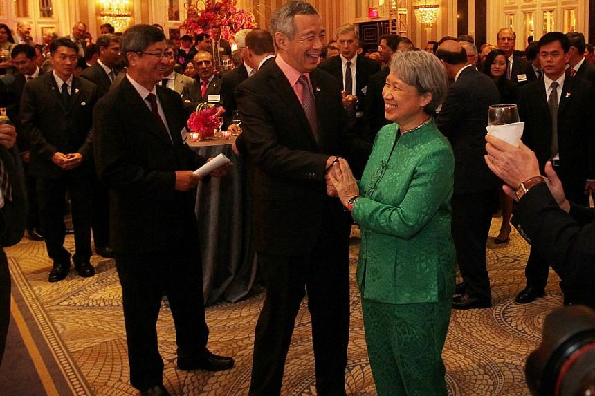 Singapore Prime Minister Lee Hsien Loong and Temasek Holdings CEO Ho Ching at the launch of the Temasek Holdings New York office launch at the Waldorf Astoria New York Hotel, in New York City, on Jun 26, 2014. --STPHOTO: NEO XIAOBIN