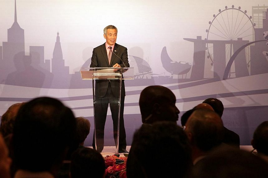 Singapore Prime Minister Lee Hsien Loong addresses the audience at the launch of the Temasek Holdings New York office launch at the Waldorf Astoria New York Hotel, in New York City, on Jun 26, 2014. --STPHOTO: NEO XIAOBIN