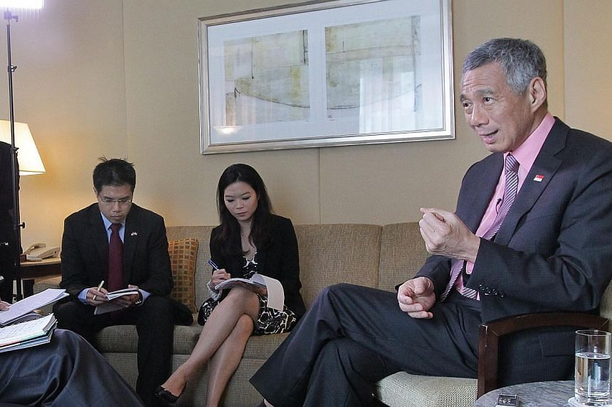 Prime Minister Lee Hsien Loong attends a local media round-up interview at the Four Seasons Hotel, in New York City, on June 26, 2014. -- ST PHOTO: NEO XIAOBIN