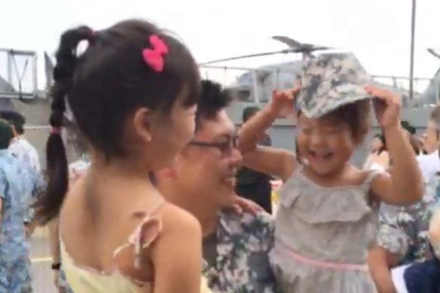 Major Desmond Tan, 33, a crew member of the RSS Tenacious reunites with his daughters Chloe, 7, and Callie, 3. --ST PHOTO: LEE JIAN XUAN