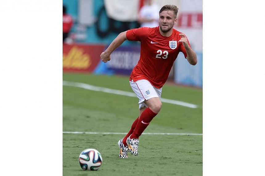 England defender Luke Shaw kicks the ball during the friendly match between England and Ecuador at Miami Sun Life Stadium in Miami Gardens, Florida on June 4, 2014. Shaw proclaimed himself to be a Manchester United player on Friday, in apparent confi