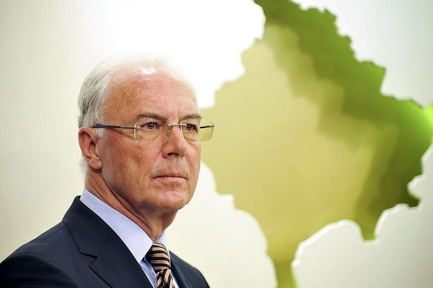 A file picture taken in Pristina on March 4, 2011, shows German football legend and FIFA executive committee member Franz Beckenbauer giving a press conference. German legend Franz Beckenbauer has had his 90-day ban from any football-related act