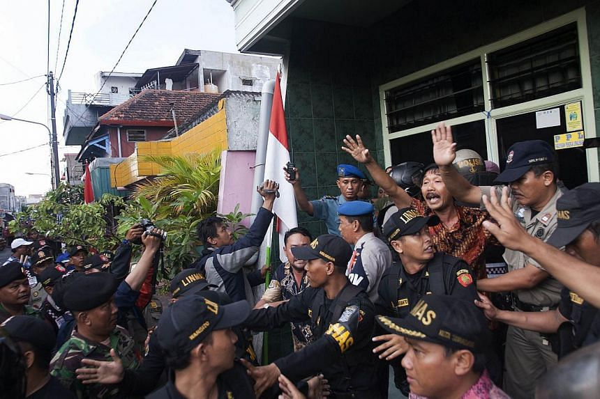 Indonesian police, civil security and army personnel conduct an operation in the red-light district, popularly known as 'Dolly', in preparation for the forthcoming Islamic holy month of Ramadan and to enforce a government closure order there in Surab