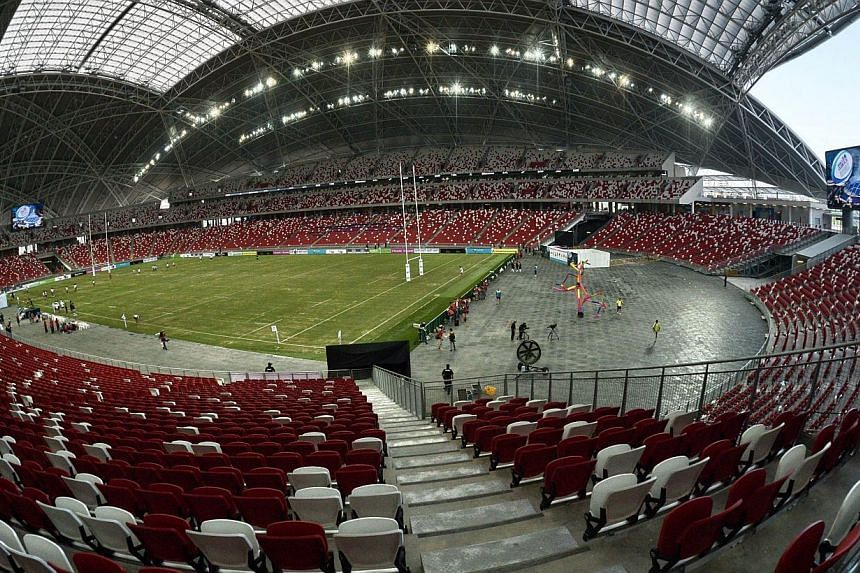 Thirteen years after the idea of a new National Stadium was mooted, the Singapore Sports Hub will throw open its doors on Monday.-- PHOTO: AFP