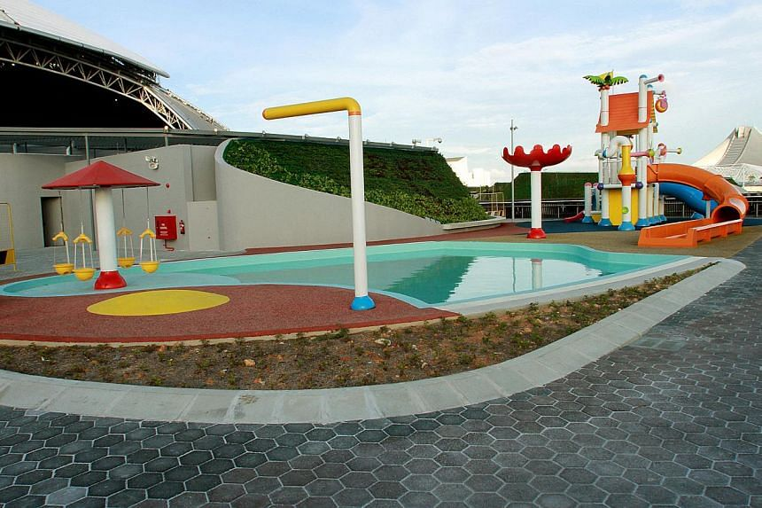 There is a water park called Splash-N-Surf for kids aged up to 12, where there is a water slide called Sting Ray and a Lazy River water ride. It will open in July, with charges to be announced later. -- ST PHOTO: LAU FOOK KONG