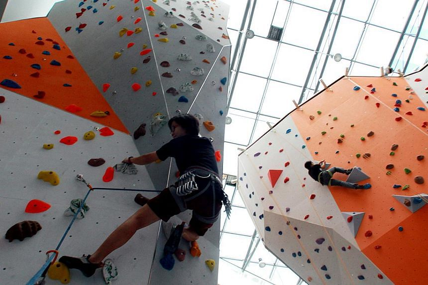 There is an indoor rock-climbing wall managed by sports company Climb Central. It will open from Saturday, with free trials at 10am and 1pm. This promotion will continue every weekend in July at 10am, 1 and 4pm.-- ST PHOTO:LAU FOOK KONG