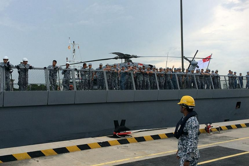 About 500 family members and friends thronged Changi Naval Base on Friday morning to welcome home their loved ones aboard the RSS Tenacious, who were away at sea for three months on anti-piracy patrols. -- ST PHOTO: LEE JIAN XUAN