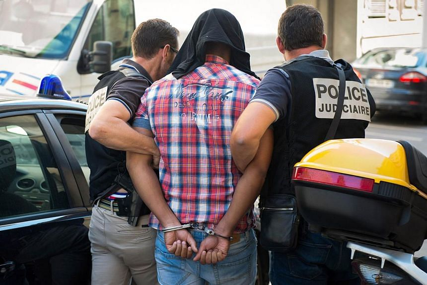 One of the two alleged suspects (centre) of the murder of 77-year-old heiress Helene Pastor arrives at the Courthouse in Marseille, southeastern France, on June 27, 2014. -- PHOTO: AFP