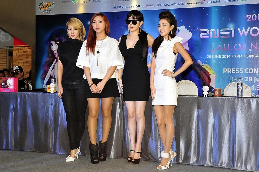Members of South Korean girl group 2NE1, (from left) CL, Minzy, Bom, and Dara, thrilled close to 3,000 fans at a press conference at Square 2 mall in Novena this afternoon. -- ST PHOTO: DIOS VINCOY JR
