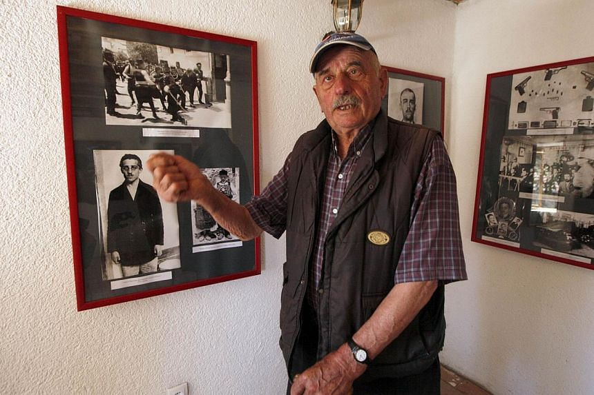 Miljko Princip, 82, a relative of Gavrilo Princip, the 19-year-old Bosnian Serb who gunned down Archduke Franz Ferdinand in 1914 and lit the fuse for World War One, speaks in the newly renovated birth house of Gavrilo Princip in Obljaj on June 27, 20