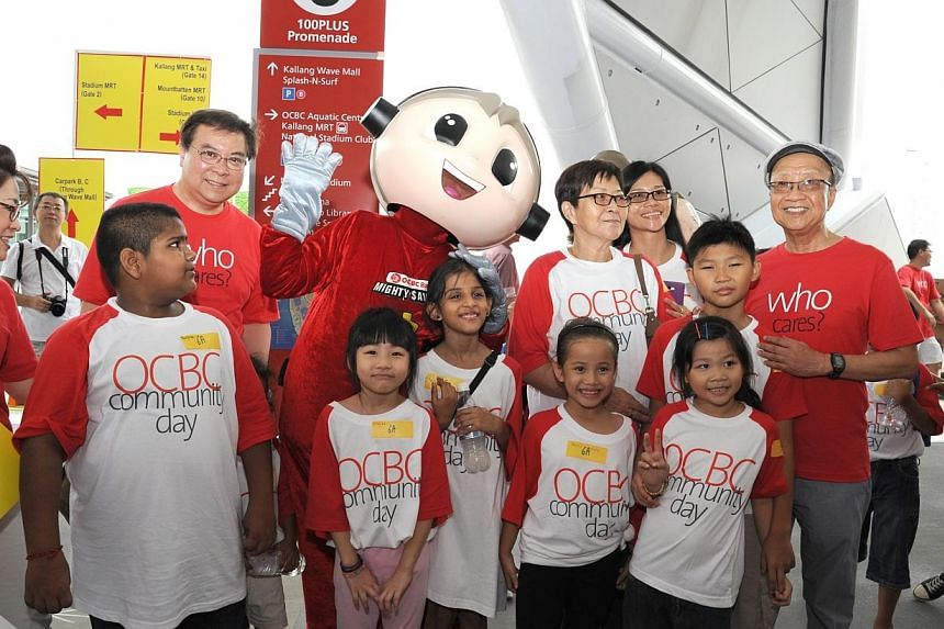 All ready to commence an 888-metre walk around the Stadium Promenade, complete with OCBC mascots Simon and Sally.-- PHOTO: OCBC