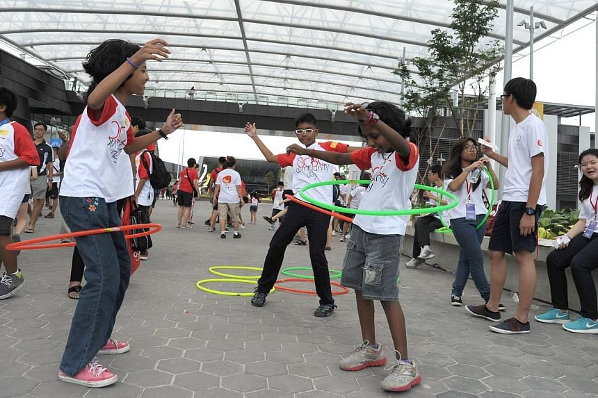 Thousands showed up the Sports Hub in Kallang on Saturday - the first weekend that the brand new $1.3 billion sporting arena opened its doors to the public.-- PHOTO: OCBC