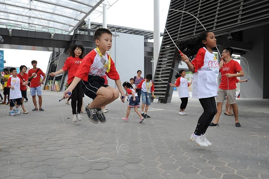 Thousands showed up the Sports Hub in Kallang on Saturday - the first weekend that the brand new $1.3 billion sporting arena opened its doors to the public. -- PHOTO: OCBC