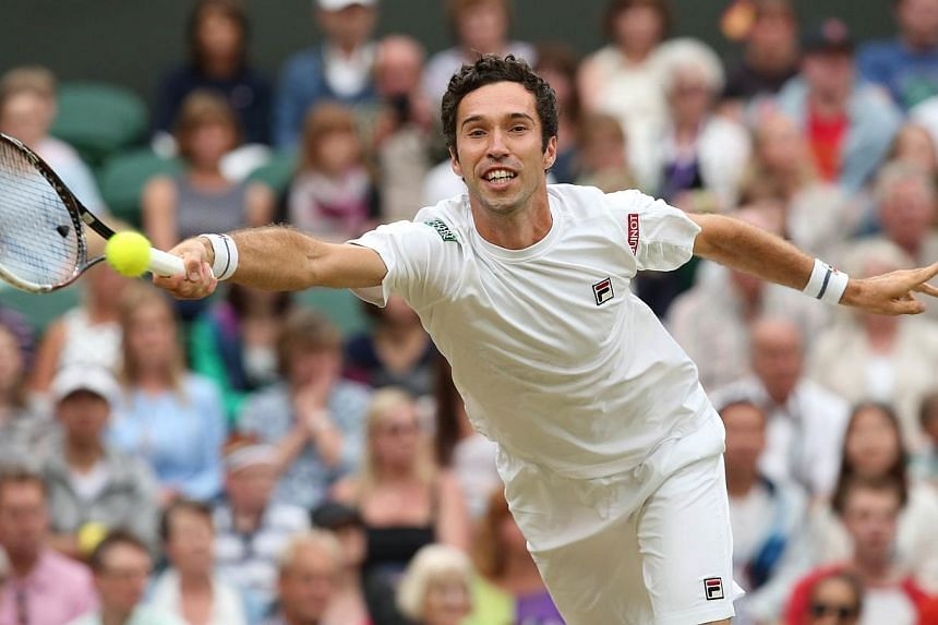 Kazakhstan's Mikhail Kukushkin returns against Spain's Rafael Nadal during their men's singles third round match on day six of the 2014 Wimbledon Championships at The All England Tennis Club in Wimbledon, southwest London, on June 28, 2014. -- PHOTO:
