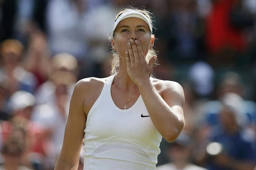 Maria Sharapova of Russia blows a kiss after defeating Samantha Murray of Britain in their women's singles tennis match at the Wimbledon Tennis Championships, in London on June 24, 2014. -- PHOTO: REUTERS