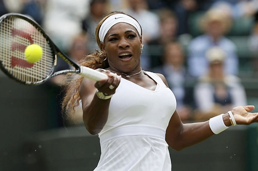 Serena Williams of the U.S. hits a return to Alize Cornet of France during their women's singles tennis match at the Wimbledon Tennis Championships, in London on June 28, 2014. -- PHOTO: REUTERS